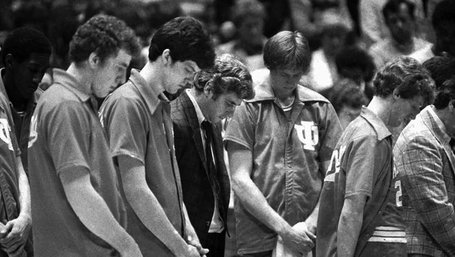 Indiana coach Bobby Knight and his players bow their heads in a minute of silence March 30, 1981 for wounded President Ronald Reagan. Scene took place at the NCAA finals in Philadelphia.(AP photo/Jack Kanthal)