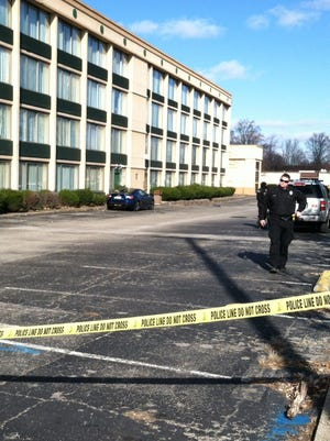 An LMPD officer is on the scene of a shooting at the Fern Valley Hotel, Friday morning, on Fern Valley Road.