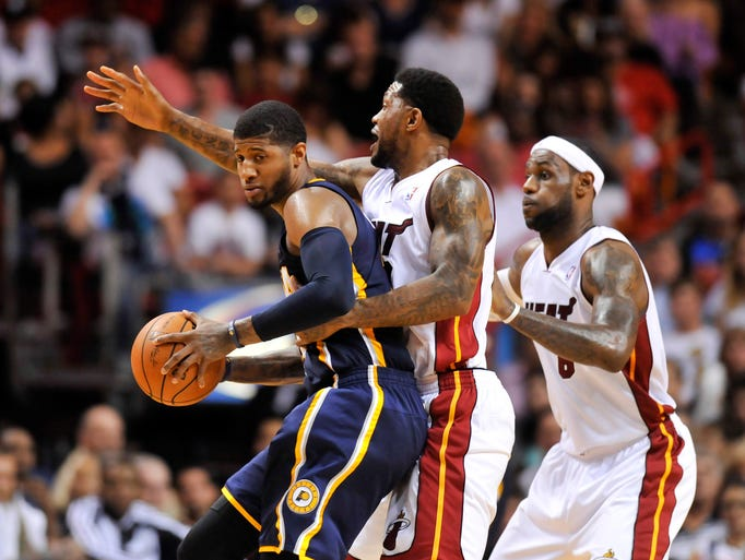 Apr 11, 2014; Miami, FL, USA; Indiana Pacers forward Paul George (24) is pressured by Miami Heat forward Udonis Haslem (40) and forward LeBron James (6) during the first half at American Airlines Arena. Mandatory Credit: Steve Mitchell-USA TODAY Sports