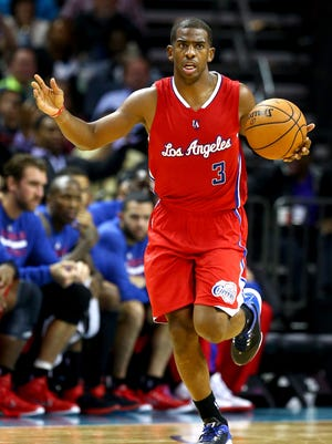 Chris Paul of the Los Angeles Clippers runs up the floor with the ball against the Charlotte Hornets on Monday, Nov. 24, 2014.
