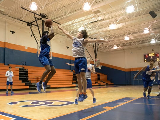 Cape Coral High School basketball players practice