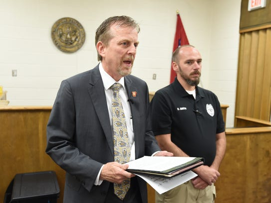 Prosecuting Attorney David Ethredge, left, announces during a press conference that his office filed a capital murder charge against Cody Allen in connection with the the death of two-year-old Alithia Boyd. Former Flippin Police Dusty Smith, right, was part of the team investigating the crime. Smith now faces charges he stole in excess of $63,000 from the city of Flippin. Those charges were brought by Ethredge's office.