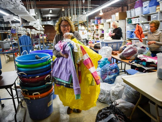 Karen Rowland divides clothing into categories as it