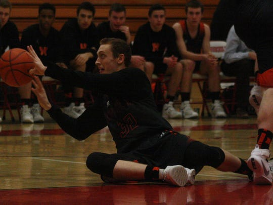 Northville's Justin Gibbons hits the floor for a loose