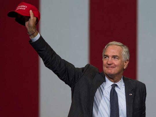 Luther Strange holds up a Make America Great Again cap   at the Strange for senate rally at the Von Braun Center in Huntsville, Ala. on Friday September 22, 2017.