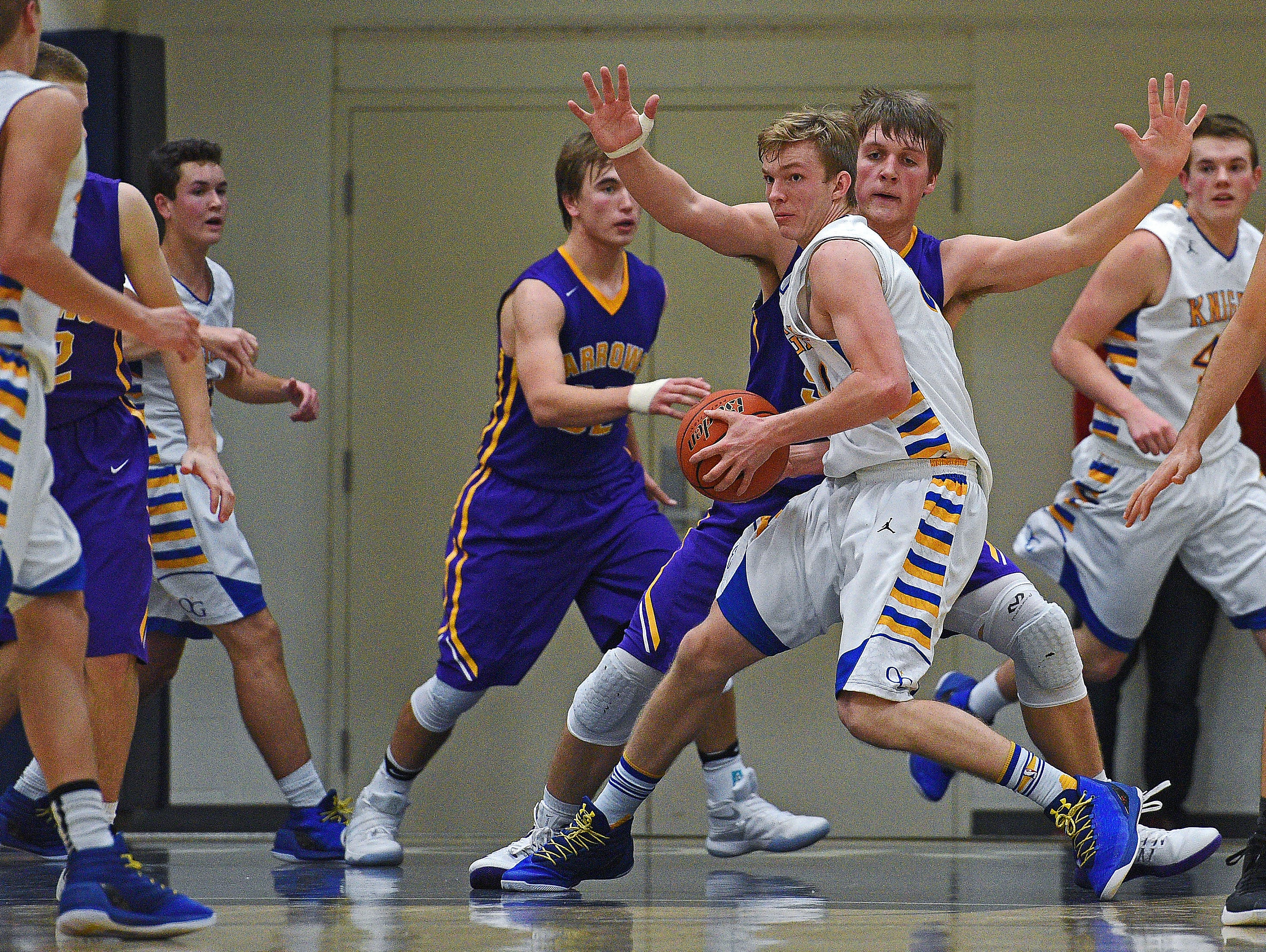 O'Gorman's JP Costello (50) works to keep the ball from Watertown's Spencer Waege (52) during a game Thursday, Dec. 15, 2016, at O'Gorman High School in Sioux Falls.