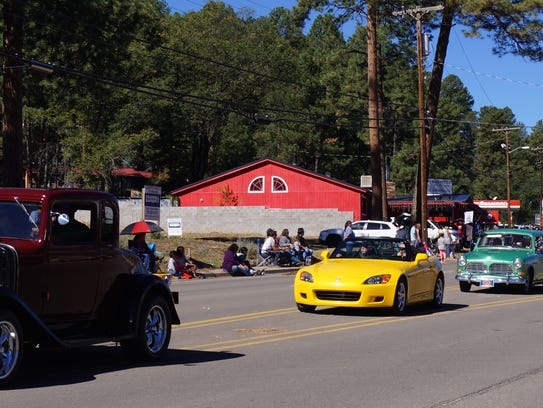 Vintage cars in AspenFest parade Saturday in Ruidoso.