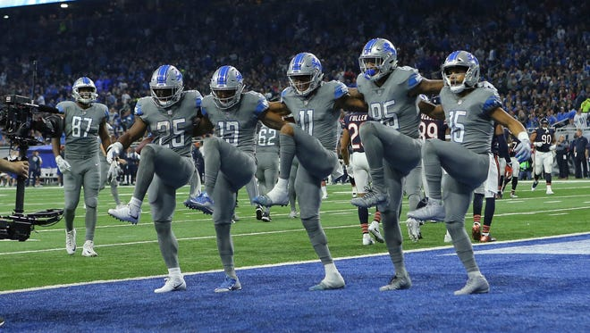 The Detroit Lions form a dance line after a touchdown catch by T.J. Jones against the Chicago Bears on Dec. 16, 2017 at Ford Field in Detroit.