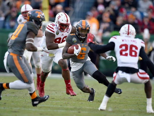 Tennessee Volunteers running back Alvin Kamara (6) gains yards in the first  half of the Franklin American Mortgage Music City Bowl at Nissan Stadium in Nashville, Tenn., Friday, Dec. 30, 2016.
