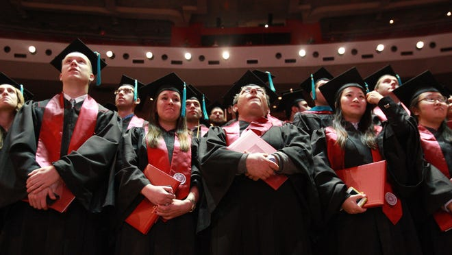 Indiana University graduates move their tassels at a commencement ceremony in Assembly Hall. (Michelle Pemberton/The Star)
