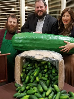 """Rabbi Pesach and Chabad Burston of Chabad of Orange County are pictured together with the """"Pickle Rabbi"""" at Chabad's Kosher Pickle Workshop in honor of Tu B'shvat in Chester."""