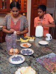 Sowmya Madabhushi and her son Rishi, 14, prepare breakfast