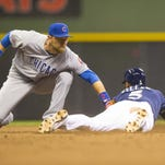 Jonathan Villar (5) of the Milwaukee Brewers is caught stealing second base by Ben Zobrist of the Chicago Cubs during the eighth inning at Miller Park.