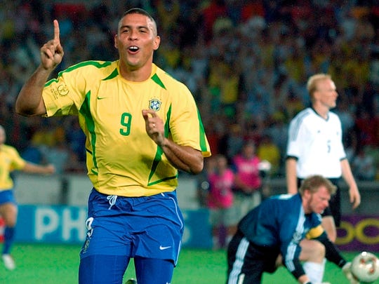 In this June 30, 2002,  file photo, Brazil's Ronaldo reacts after scoring past Germany's goalkeeper Oliver Kahn, center, and Carsten Ramelow during the 2002 World Cup final soccer match at the Yokohama stadium in Yokohama, Japan.