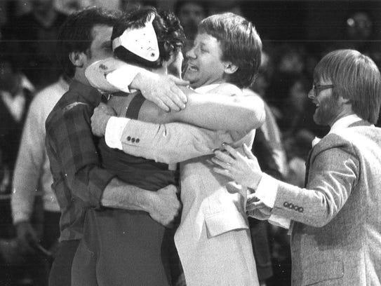 1982: Bondurant-Farrar Coach Ken Estling hugs 167-pound
