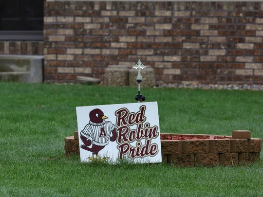 A sign sits in the front lawn of a home along 10th Avenue depicting the Antigo High School mascot, April 25, 2016. A school shooting at the prom left the perpetrator dead and two others injured with gunshot wounds.