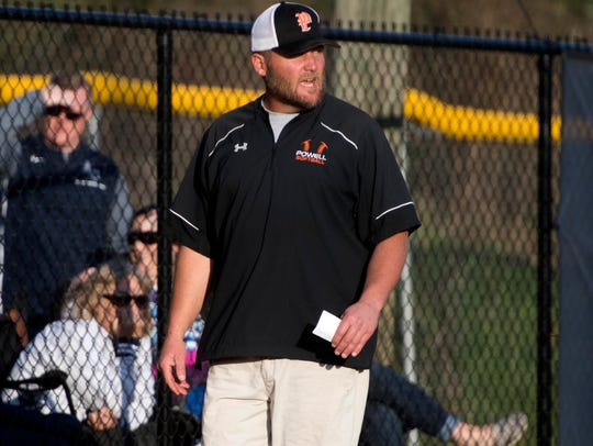 Powell softball coach Jeff Inman yells out directions