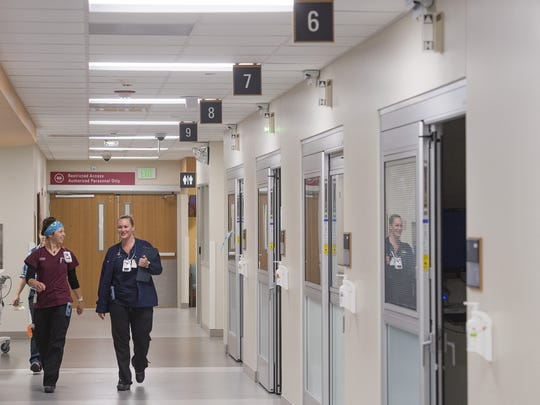 Emergency room staff work at Poudre Valley Hospital