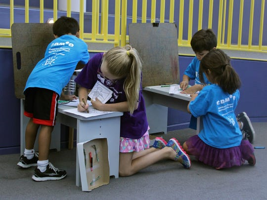 A group of children color together, Monday, at the Children's Discovery Museum in Rancho Mirage.