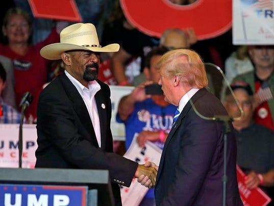 Milwaukee County Sheriff David A. Clarke Jr. (left) greets Donald ...