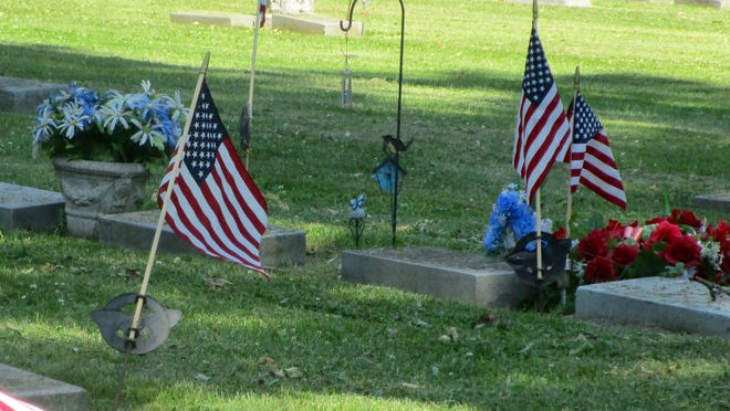 Flags wave over Veteran's resting places courtesy of Bob DeBoever. Photo by Claudia Loucks