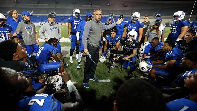 Memphis coach Mike Norvell stops his team for a little motivation during the Tigers' annual spring scrimmage at the Liberty Bowl.