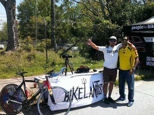 """Manny Cervantes, left, and Luis Eduardo Villamizar pose shortly before Cervantes death in 2014. Villamizar, a friend of Cervantes' and a film producer, spent the past four years helping to finish """"Bikelantis,"""" a documentary Cervantes had spent two years working on."""