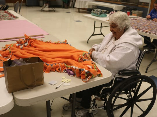 Toni Weiland crafts a fleece blanket at St. Gerald's social hall.