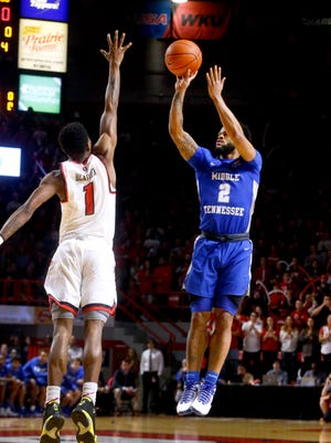 MTSU's Antwain Johnson (2) goes up for a shot as Western Kentucky's Lamonte Bearden (1) defends on Saturday.