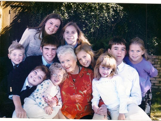 Madge with grandkids.jpg