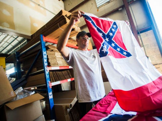 Warehouse employee Scott Myers works taking inventory of Confederate flags at the flag manufacturer Quinn Flags on Wednesday June 24, 2015 on West Chestnut Street in Hanover. In light of the recent shooting in Charleston, South Carolina the Hanover based flag manufacturer is removing the flags from their inventory and ceasing sales of the products, as stated in a press release by company president Matthew Quinn.