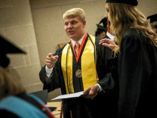 Hanover High School valedictorian Garrett Reichart goes over instructions with classmates before walking in their commencement ceremony at the school earlier this month. (File   GameTimePA.com)