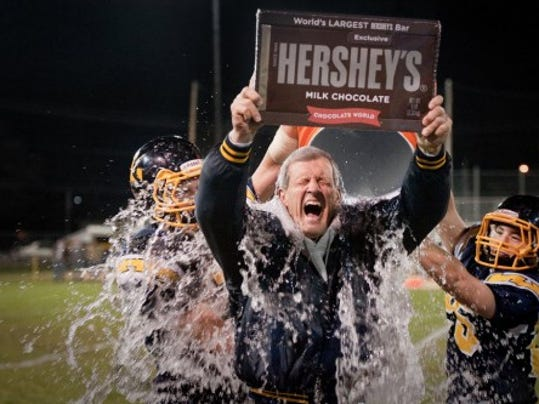 Littlestown head coach Mike Lippy is showered with an ice water bath by Lucas Reynolds and Cole Warner as he hoists a giant Hershey's bar following the Bolts' 29-23 win against Wyomissing. (Jeff Lautenberger -- For GameTimePA.com)