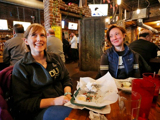 Sarah Mueller, left, and Heather Pasley smile as they watch Purdue play Cal State Fullerton in the NCAA basketball tournament Friday, March 16, 2018, at DT Kirby's, 644 Main Street in downtown Lafayette. Both women are graduate students at Purdue.