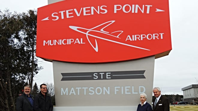 Stevens Point Municipal Airport dedicates new sign commemorating the accomplishments of local hero Conrad Mattson. In the picture from left to right are Stevens Point's Mayor, Mike Wiza, Airport Manager, Jason Draheim, Carole Cassidy and Tom Thomas.