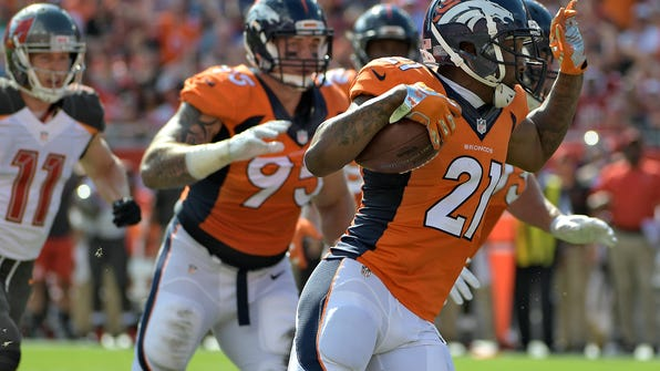 Denver Broncos cornerback Aqib Talib (21) runs with the football after intercepting a pass by Tampa Bay Buccaneers quarterback Jameis Winston during the first quarter of an NFL football game Sunday, Oct. 2, 2016, in Tampa, Fla. (AP Photo/Phelan Ebenhack)