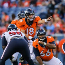 DENVER, CO - AUGUST 23:  Quarterback Peyton Manning #18 of the Denver Broncos runs the offense against the Houston Texans during a preseason game at Sports Authority Field at Mile High on August 23, 2014 in Denver, Colorado.
