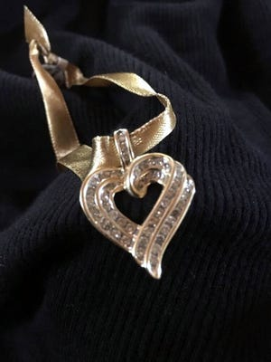 This diamond and gold pendant valued at $1,500 will be one of the premier prizes up for auction during the Deming Animal Guardians annual PetPourri Party.