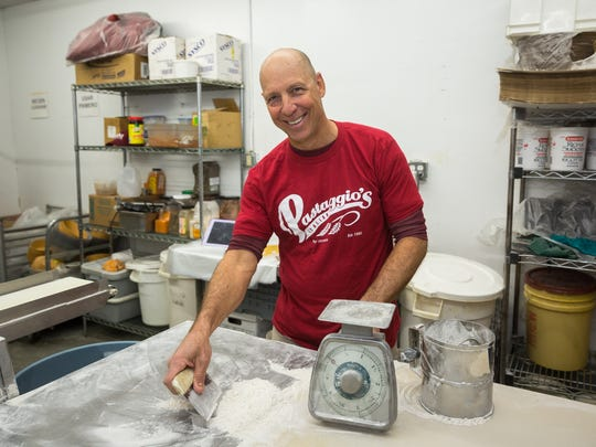 Lorenzo Liberto works in the dough room of his restaurant Pastaggios Italian Cuisine and Pizza.  Liberto usually works from 7:30 in the morning preparing dough for his restaurant's pizzas and bread.