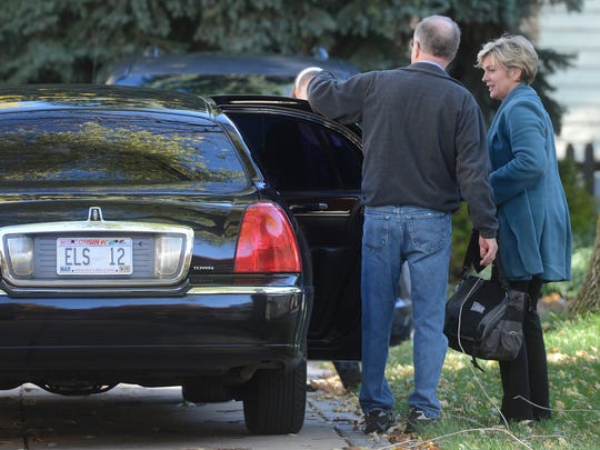 Volunteer Rich Langan greets former Michigan governor Jennifer Granholm as she arrives Saturday at a private fundraiser for Mary Burke in Green Bay.
