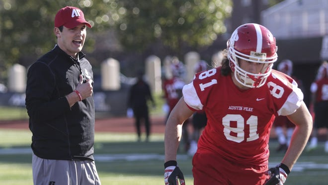 New Austin Peay football coach Will Healy watches senior Trey Salisbury run drills during the first day of spring football practice.