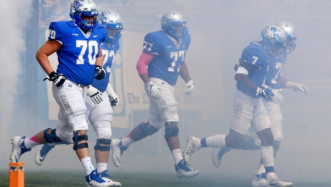 MTSU players run onto the field before a game against FIU on Oct. 7, 2017.