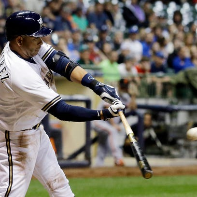 Milwaukee Brewers' Aramis Ramirez hits a sacrifice fly during the sixth inning against the San Francisco Giants Tuesday in Milwaukee.