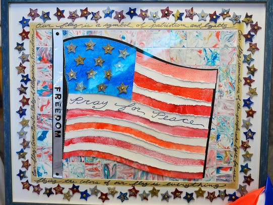 A framed flag is comprised of many pieces made by the