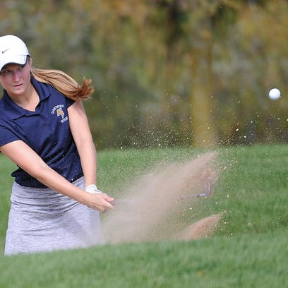 Appleton North's Sydney Maule blasts from the sand during the WIAA Division 1 sectional at Thornberry Creek on Tuesday.