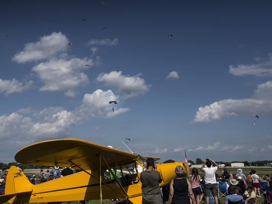 Skydivers jump in an attempt to break a World Record during Wednesday's AirVenture July 22, 2015.