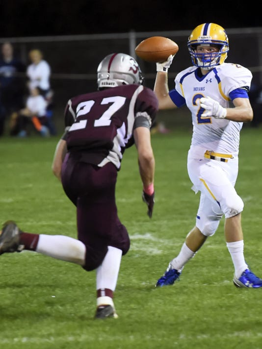 Waynesboro's Matt Peck, right, looks for a pass out of the wildcat formation against Shippensburg's Cameron Tinner on Friday. The Greyhounds won, 31-27, after some wild play-calling by the Indians in the final minute of the game.
