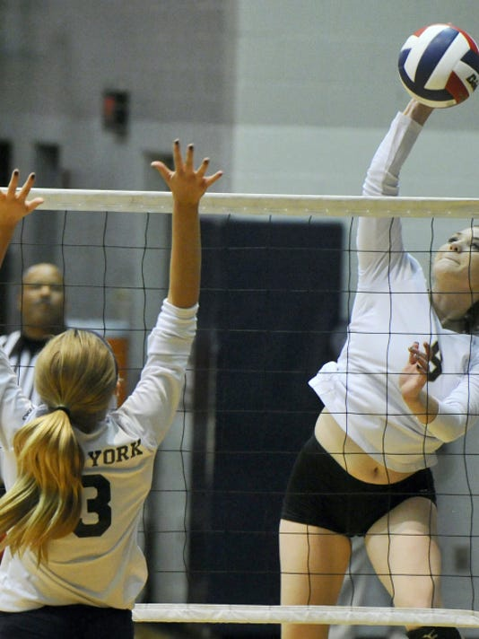 Delone Catholic's Lilly Singleton records a kill during a 3-0 victory against West York in the first round of the YAIAA tournament at Dallastown on Monday.
