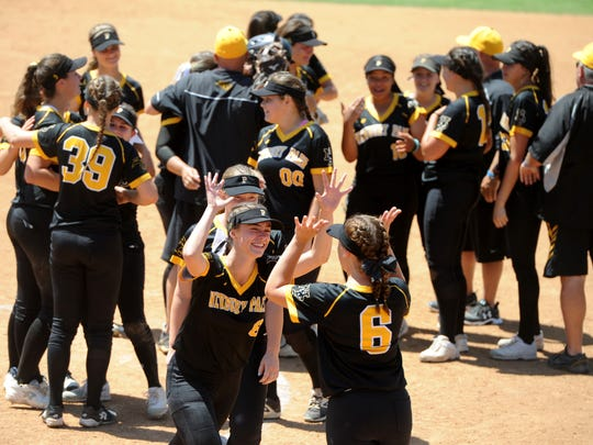 Newbury Park High softball players celebrate their 3-1 win over Riverside-ML King in the CIF-SS Division 2 championship game Saturday in Irvine.