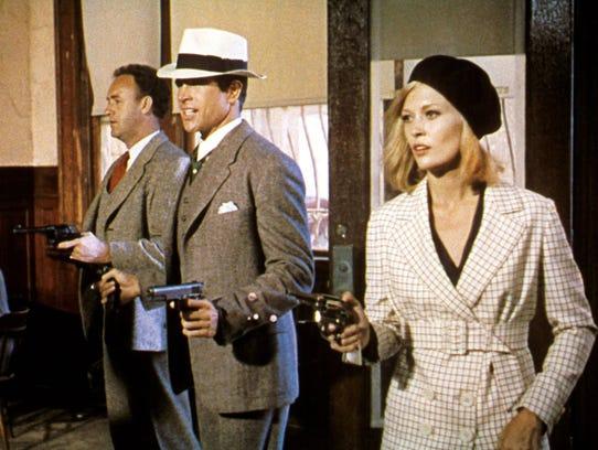 Gene Hackman, Warren Beatty and Faye Dunaway in a scene